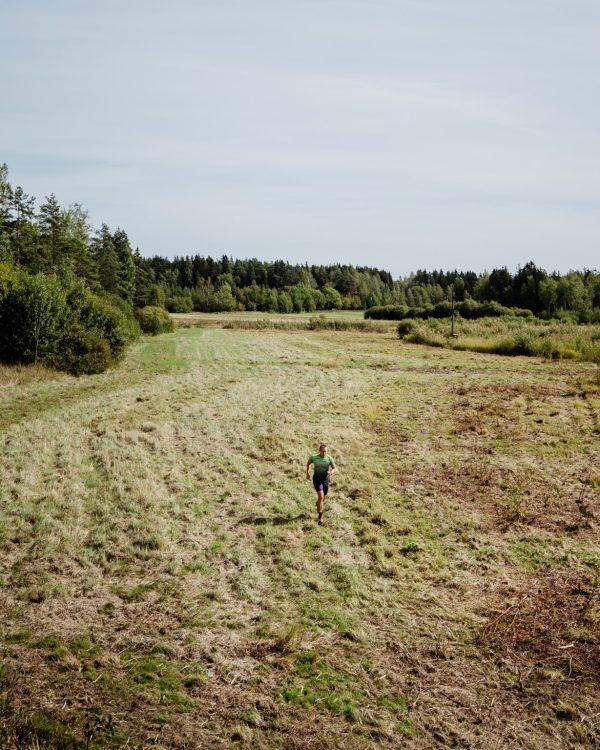 man running in a field