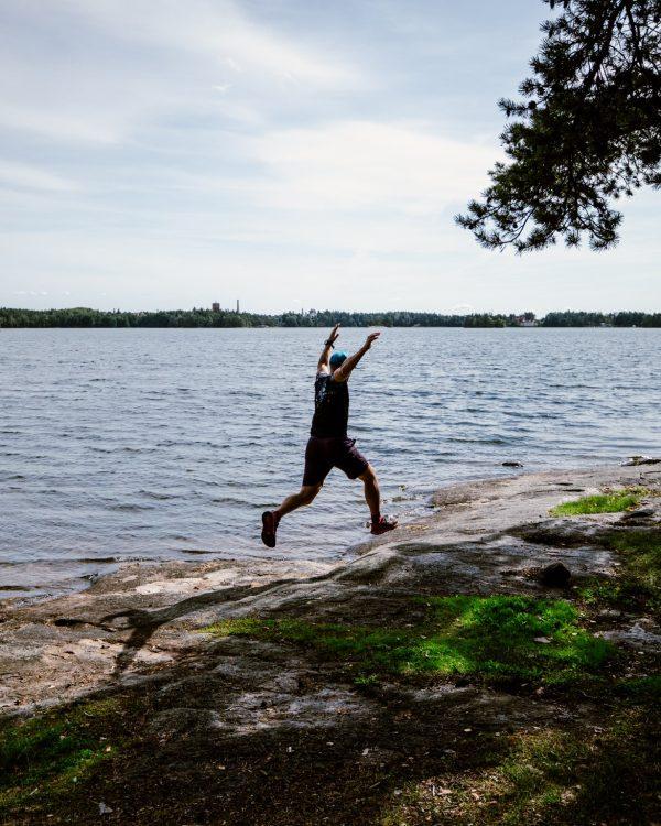 man running on seashore