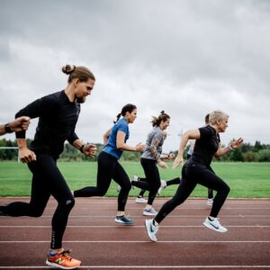 group running on a running track